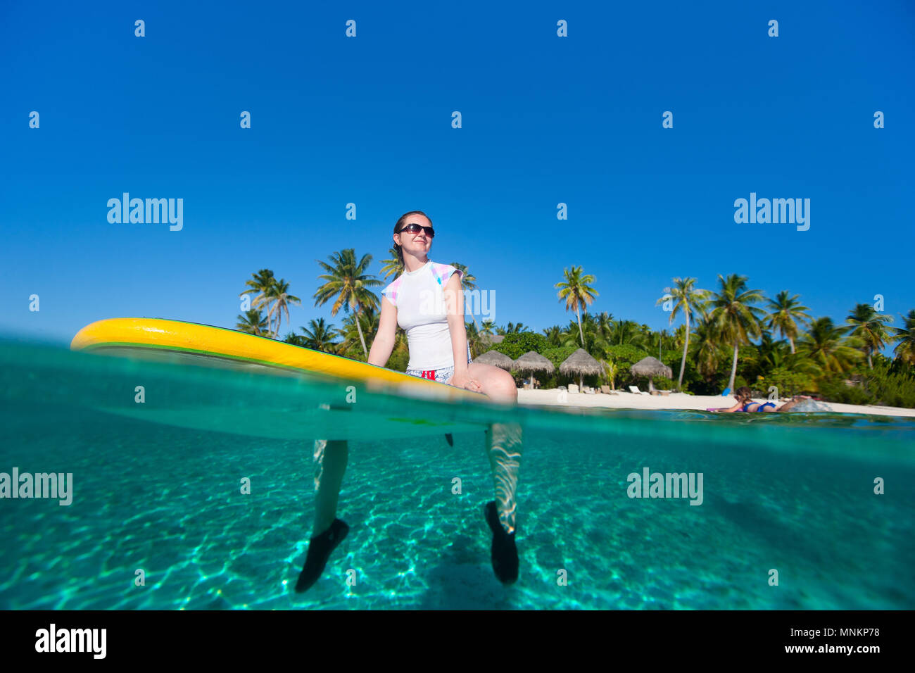 Young sporty woman on paddle board - Stock Image
