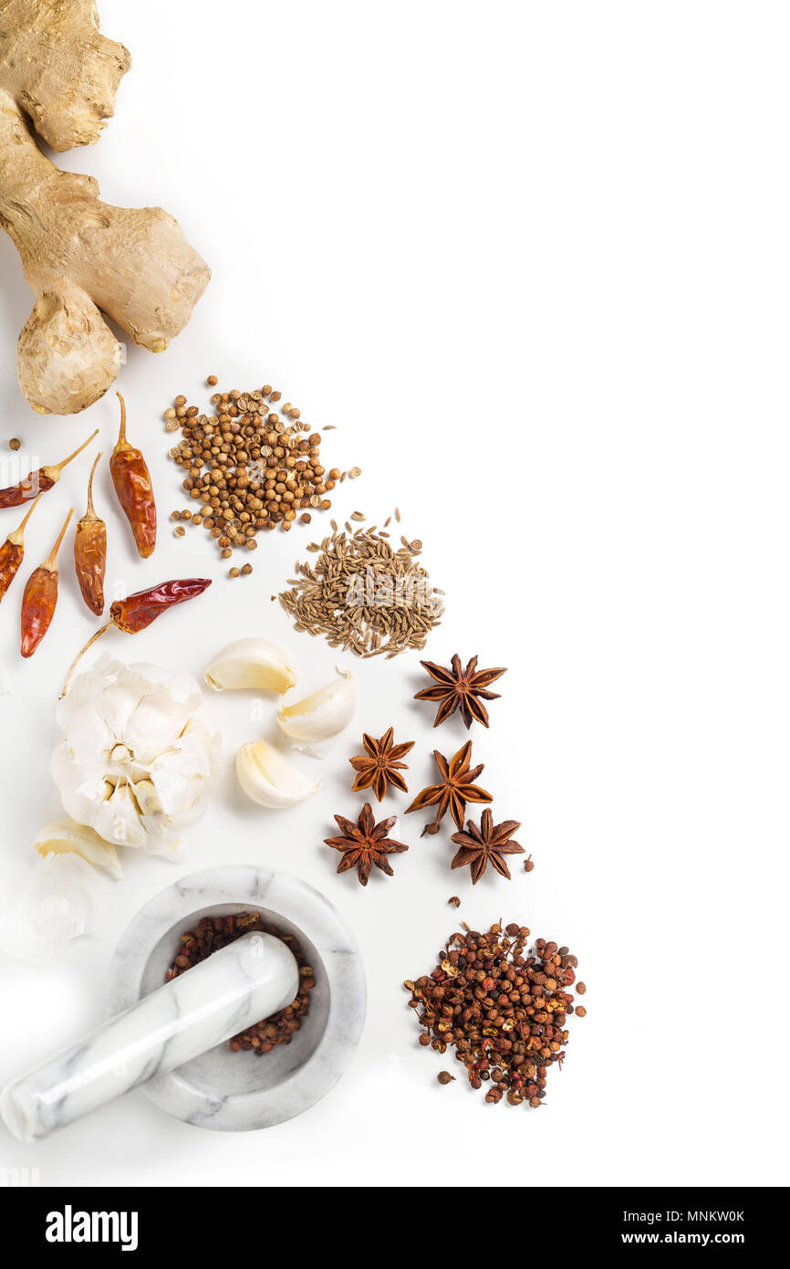 Overhead view of ingredients for cooking Asian recipe. Spices on a plain white background - Stock Image