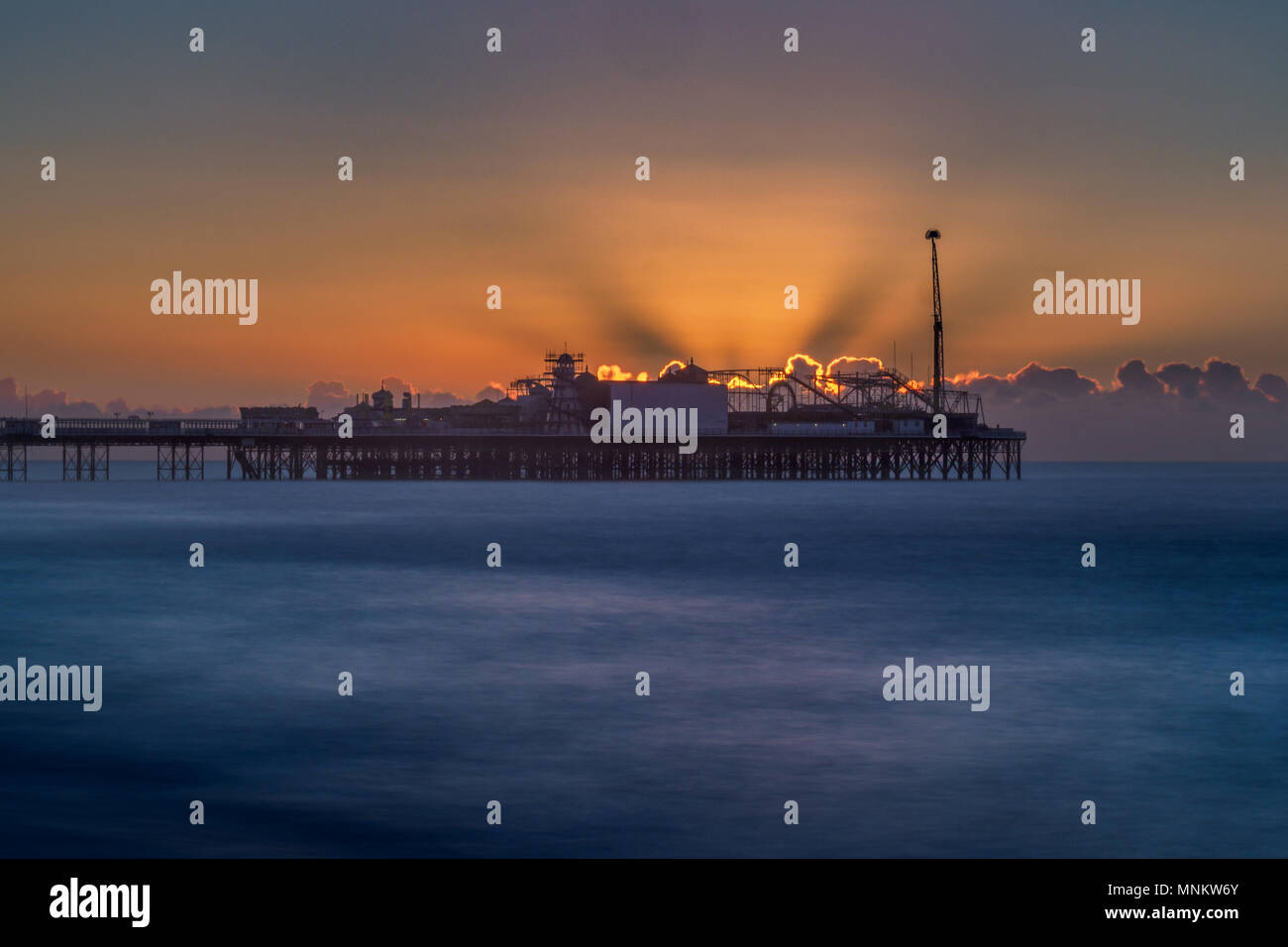 Light show behind Brighton Pier - Stock Image