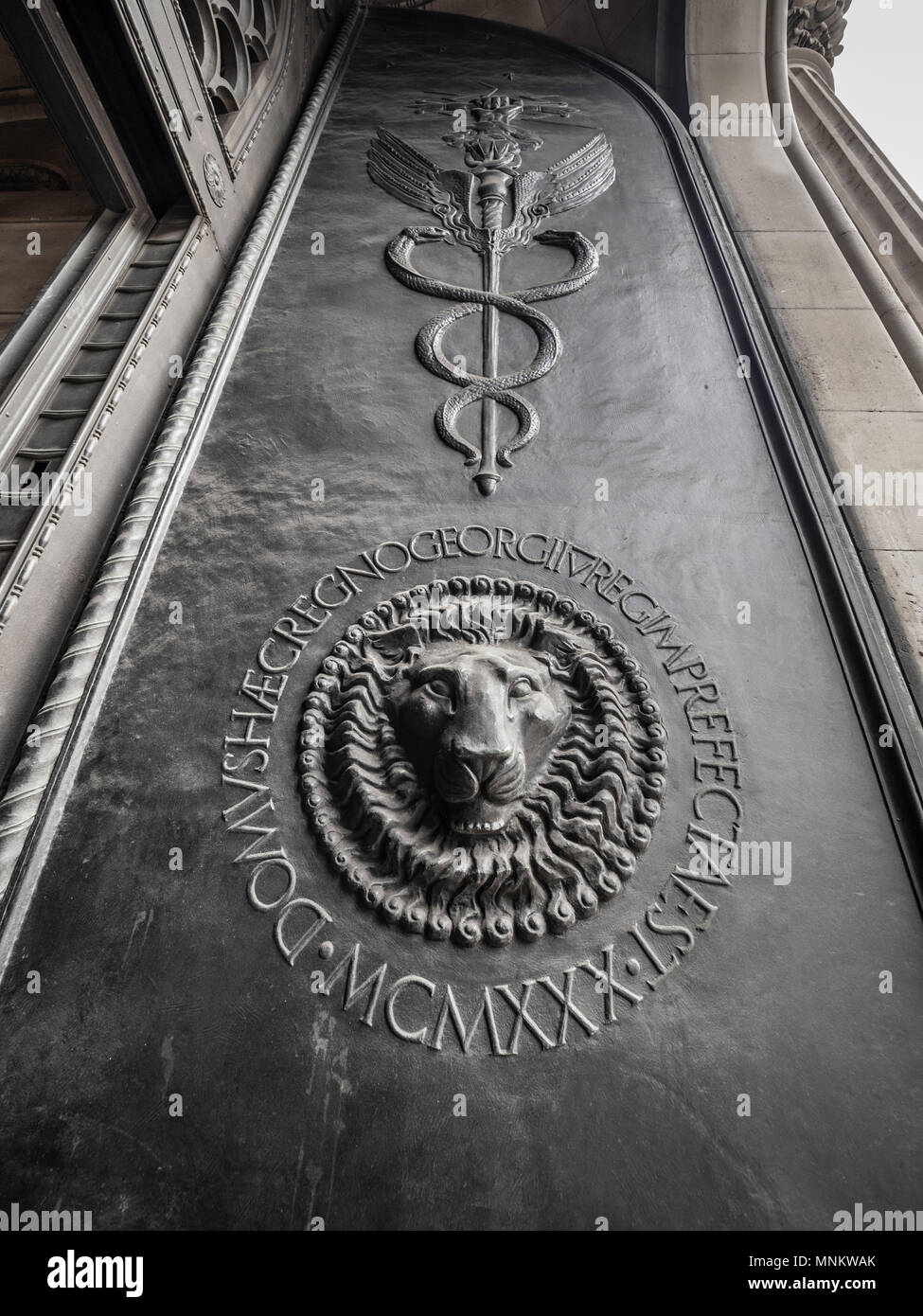Lions head on front door of Bank of England, London, UK. - Stock Image