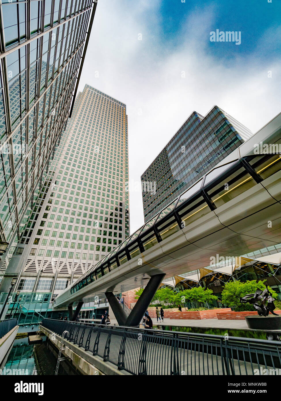 Adams Plaza Bridge, entrance to Crossrail Place, Canary Wharf, London, UK. into Crossrail Place, with One Canada Square skyscraper in background, Cana - Stock Image