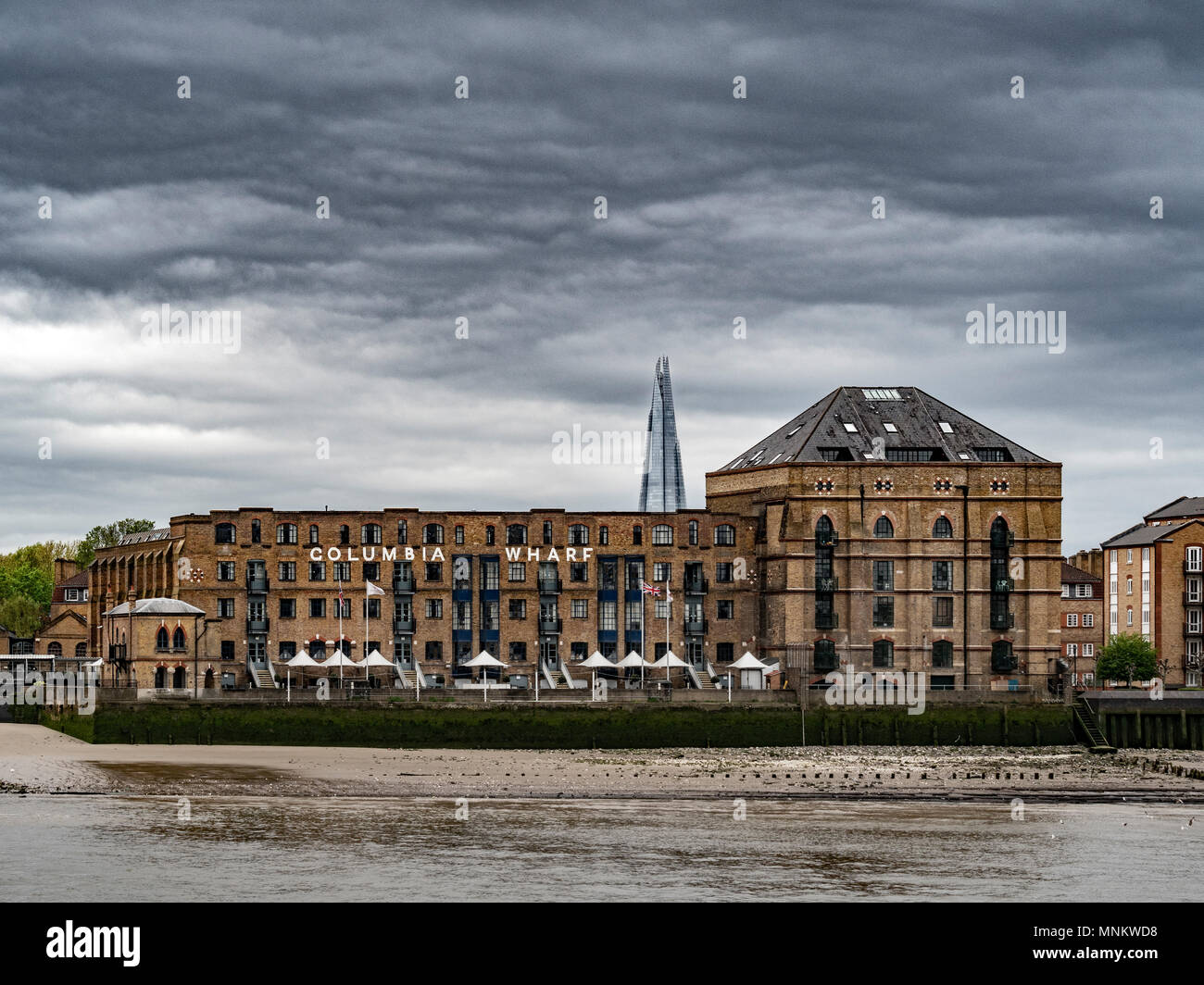 Columbia Wharf (Colombia Wharf), listed building in Rotherhithe, south bank of the River Thames with the Shard in the background. - Stock Image