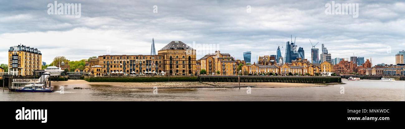 Columbia Wharf (Colombia Wharf), listed building in Rotherhithe, south bank of the River Thames with London City financial district in background. - Stock Image