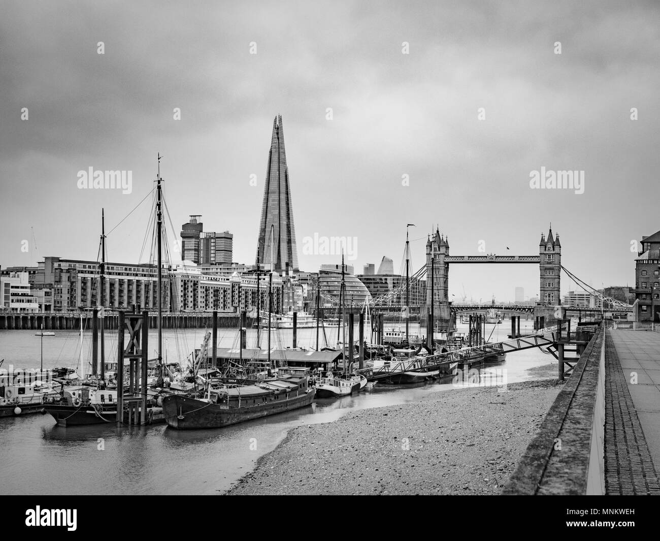 River Thames, boats, Tower Bridge and the Shard from the North bank of the river, London, UK. - Stock Image