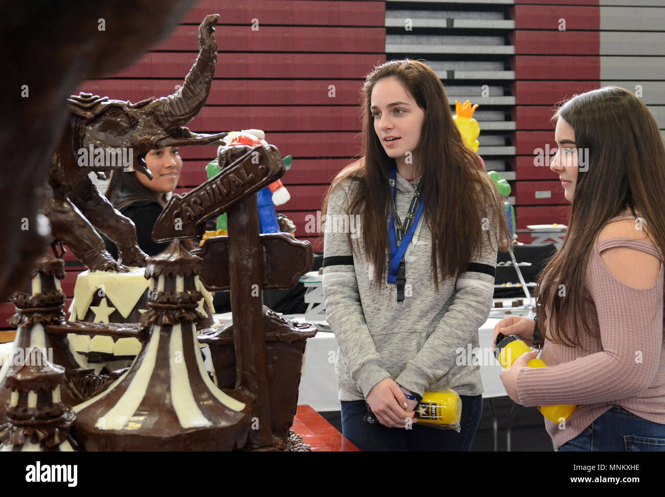 Fort Lee Va Nottoway High School Sophomores Mikayla Iron And Chalie Scott Are Captivated By The Intricate Details Of A Circus Scape Molded From Different Types Of Chocolate By A Military Team