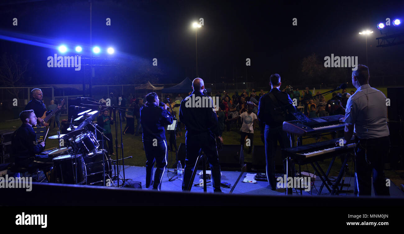 The U.S. Air Forces in Europe Band plays their last song at a U.S. Embassy celebration in Dakar, Senegal, March 17, 2018. The band assists in building and strengthening relationships with partner nations during military engagements like African Partnership Flight Senegal. - Stock Image