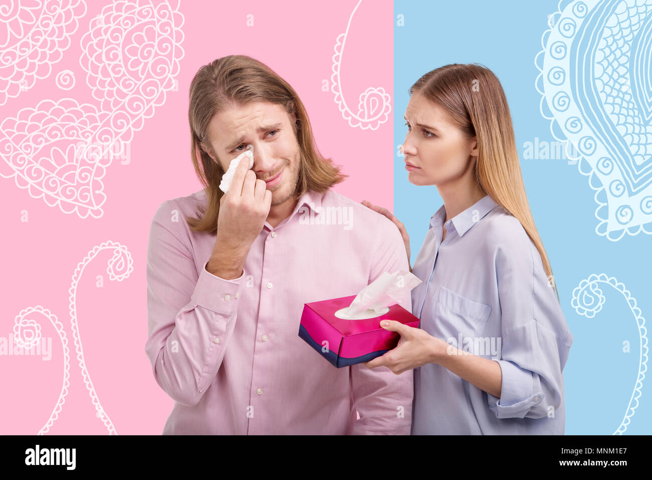 Kind wife comforting her crying husband and looking at him Stock Photo