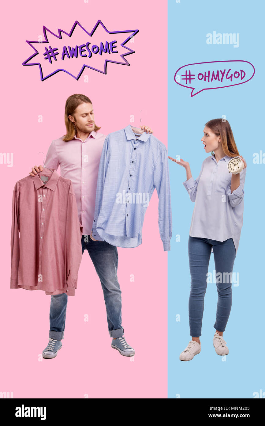 Angry wife screaming and her slow husband choosing a shirt - Stock Image