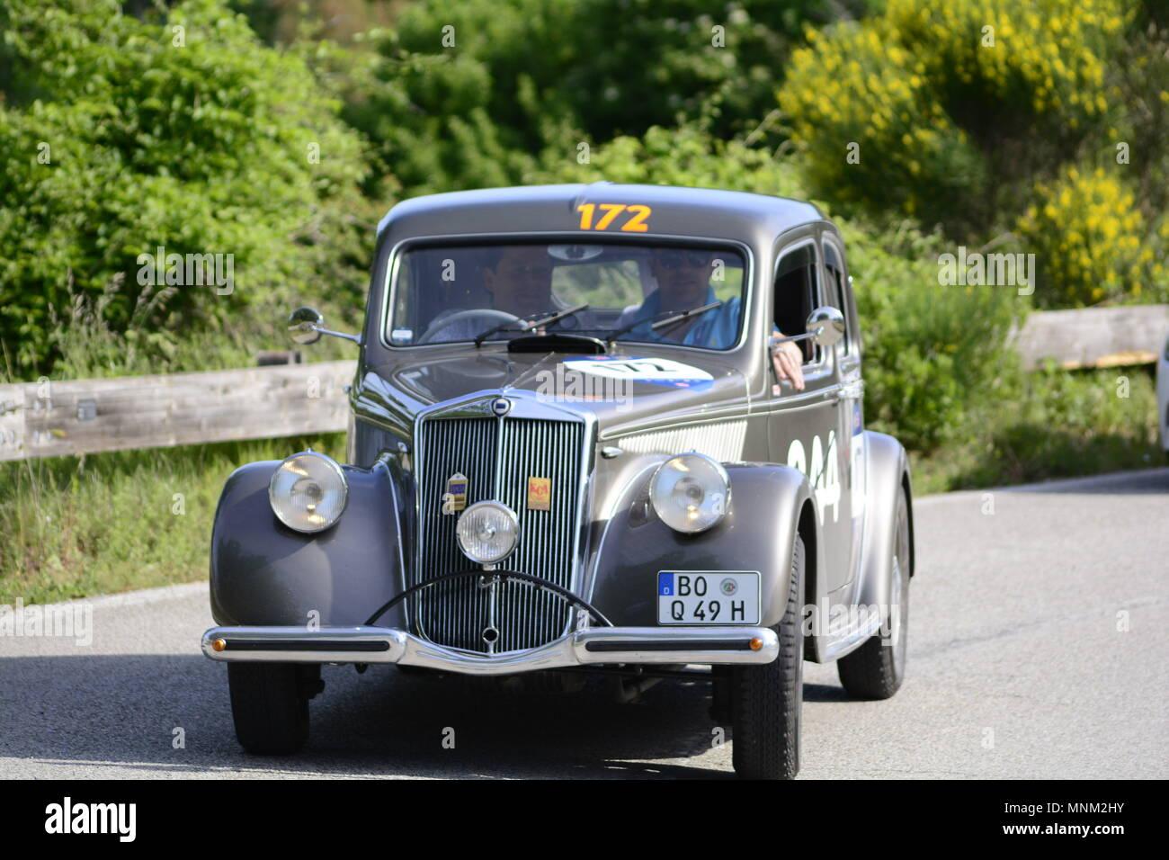 PESARO COLLE SAN BARTOLO , ITALY - MAY 17 - 2018 : LANCIA APRILIA 15001949  on an old racing car in rally Mille Miglia 2018 the famous italian h - Stock Image