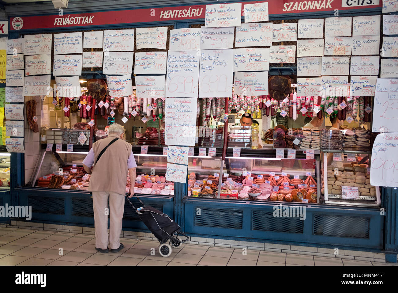 An unidentified man with a cart shops for meat at the Central Market in the Pest section of Budapest, Hungary. Stock Photo