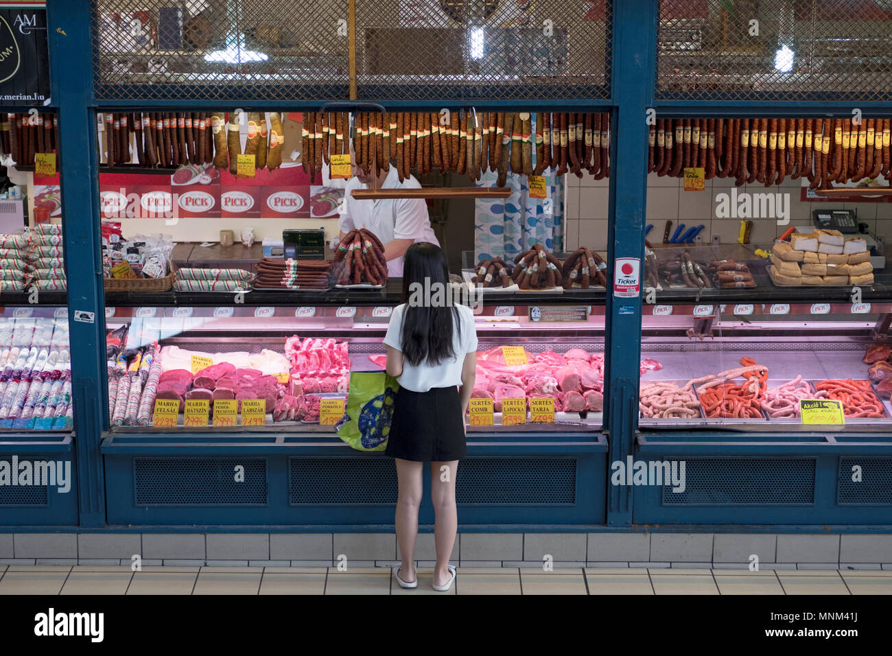 Colorful tourist items for sale at the Central Market in the Pest section of Budapest, Hungary. Stock Photo