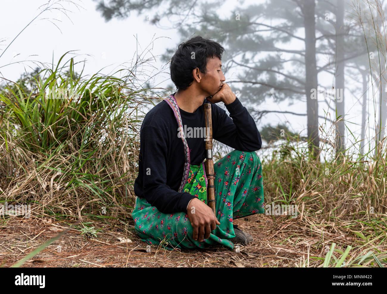 Thai hilltribe park ranger in Khun Chae National Park (อุทยานแห่งชาติขุนแจ) in Northern Thailand - Stock Image