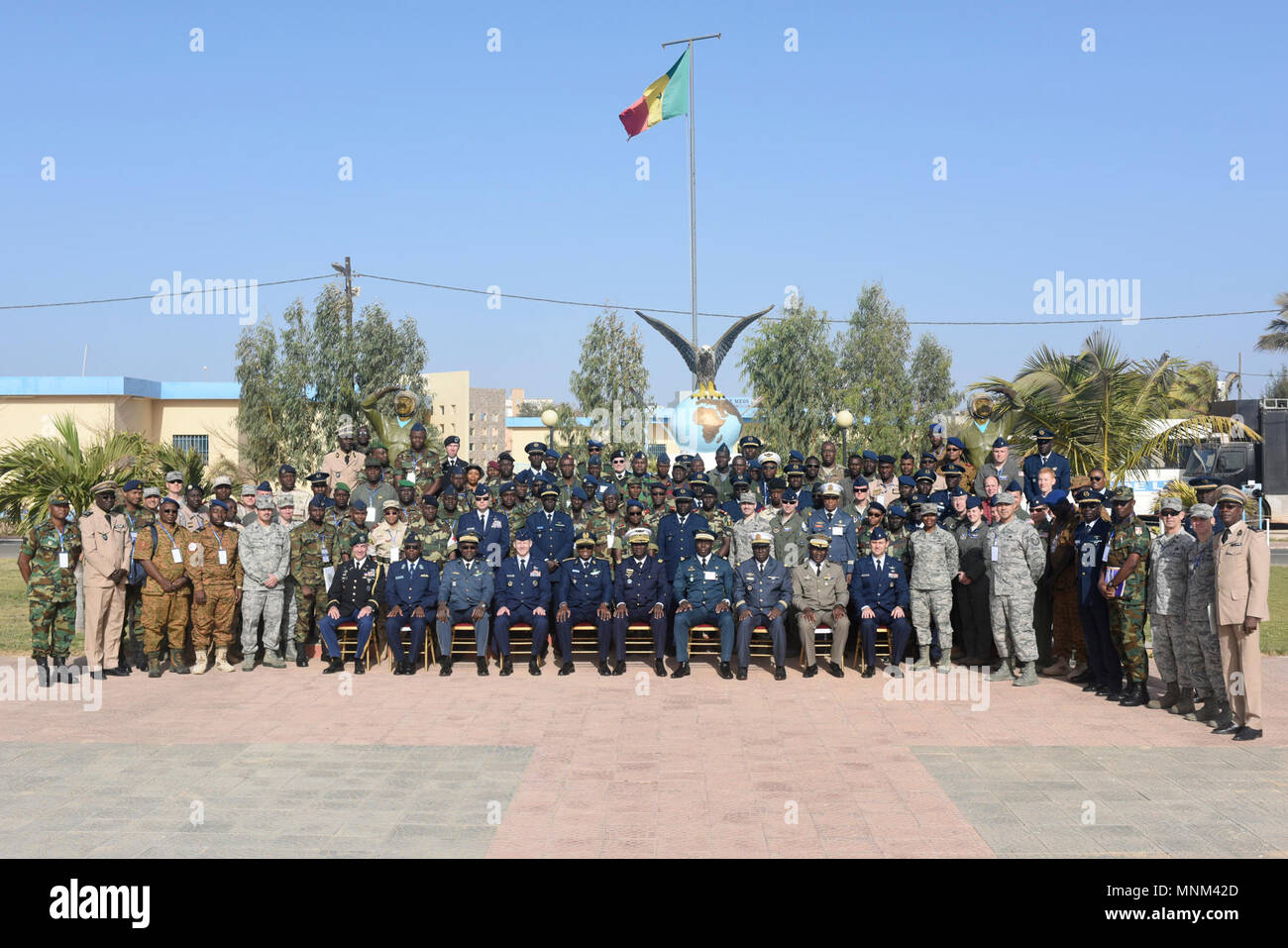 Participants of African Partnership Flight Senegal pose for a photo after the opening ceremony of APF at Captain Andalla Cissé Air Base, Senegal, March 19, 2018. Ten nations are participating in this event, which will focus on casualty evacuation, aeromedical evacuation, as well as air and ground safety. - Stock Image