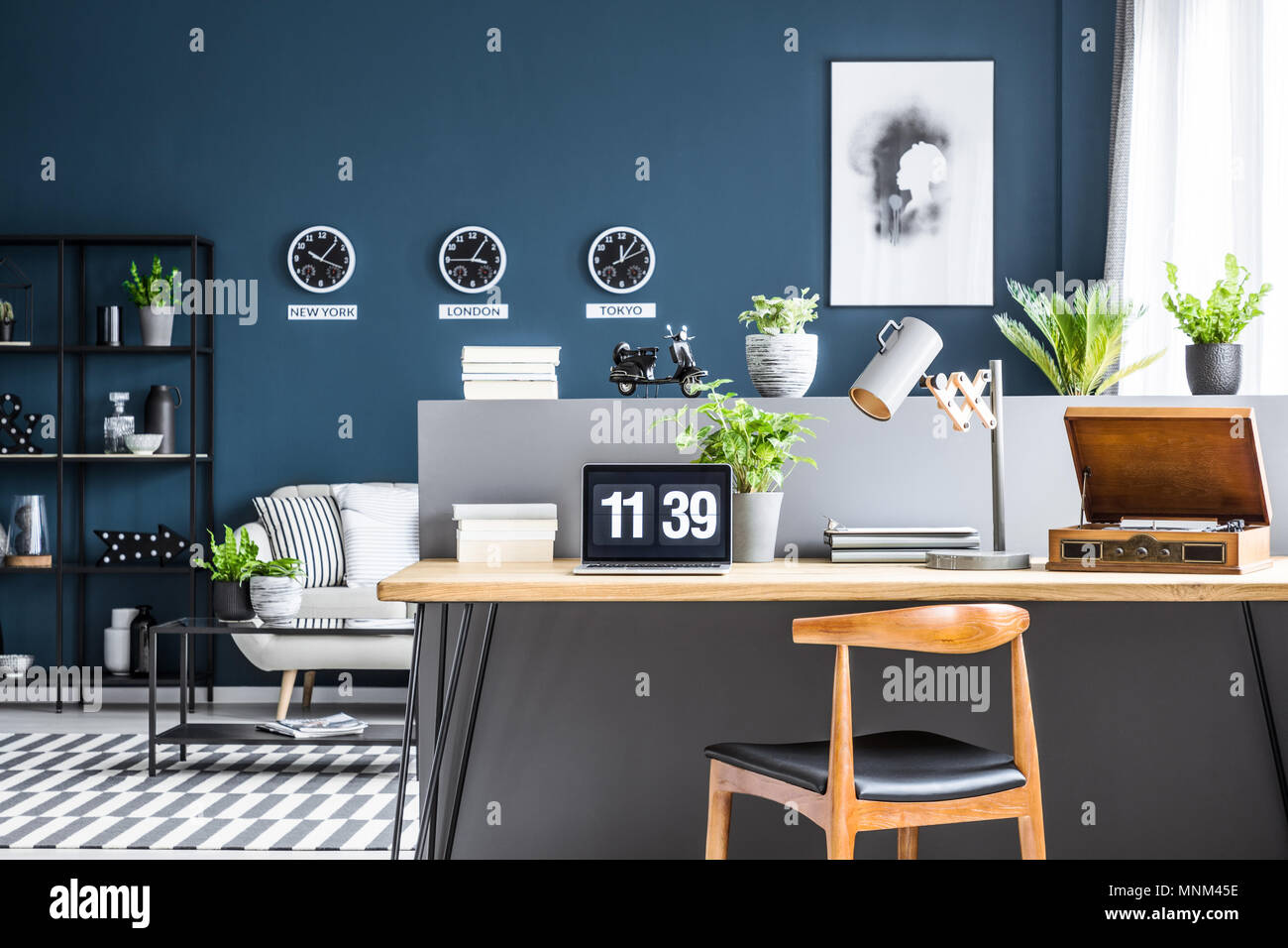 Dark Blue Living Room Interior With Black Industrial Racks And Stylish Workspace By A Gray Half