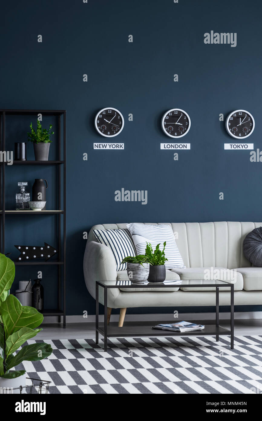 Green plants in a classy, navy blue living room interior ...