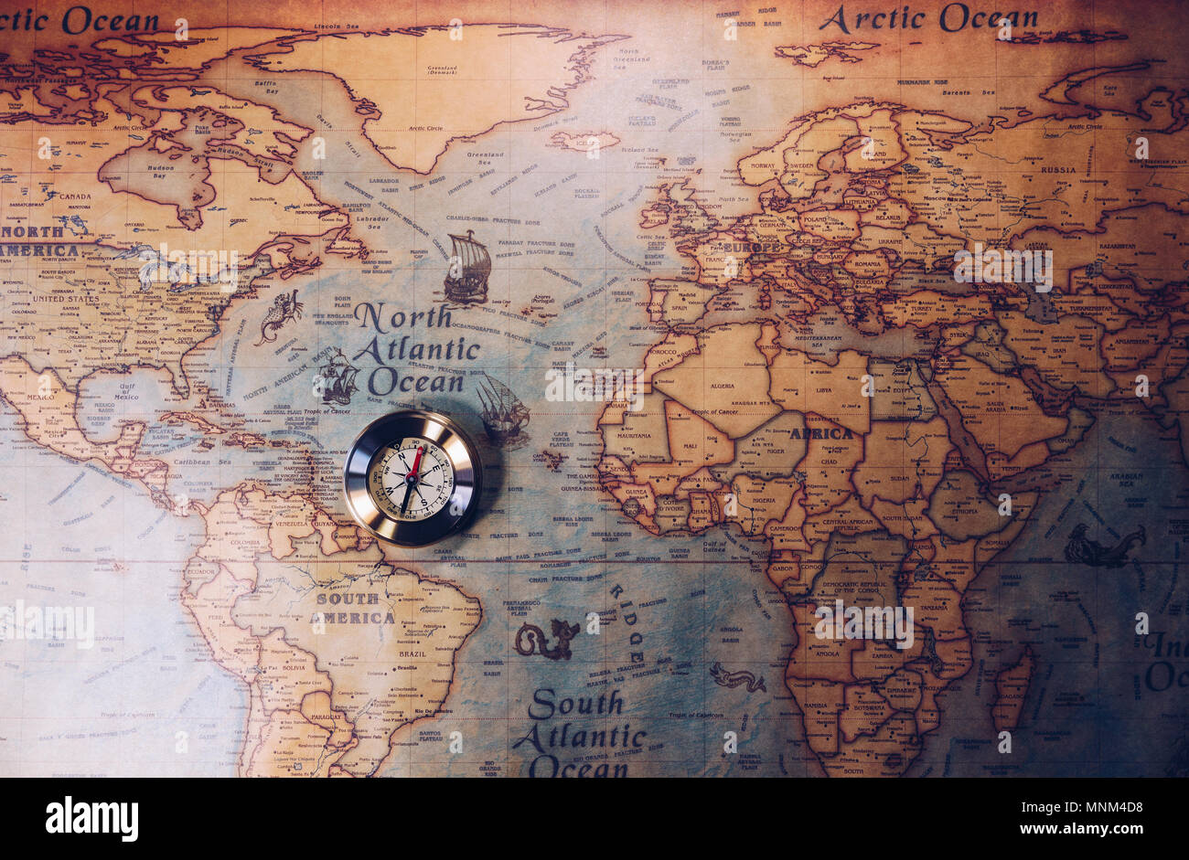 Old compass on vintage map  Adventure stories background