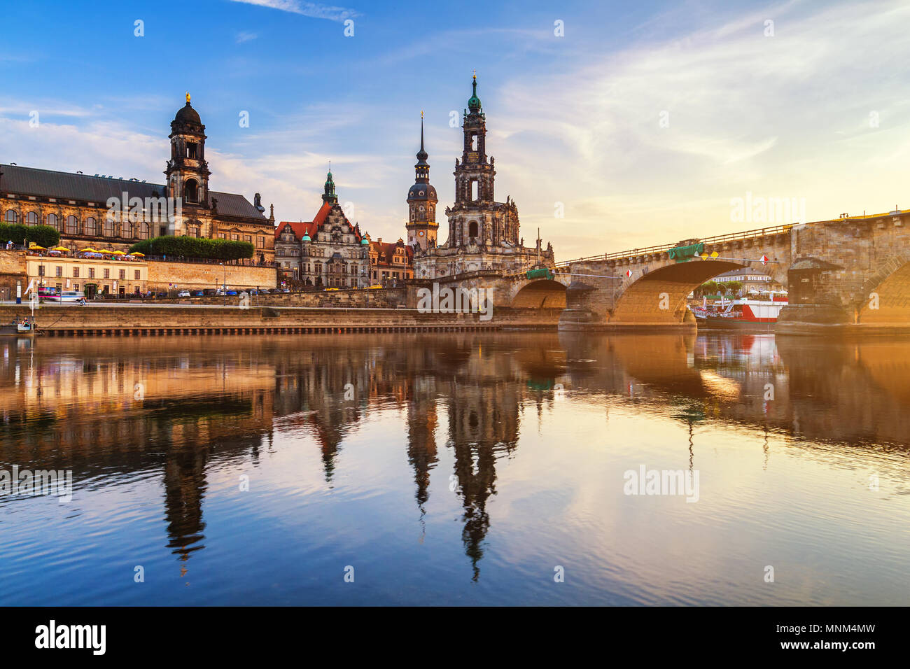 Augustus Bridge (Augustusbrucke) and Cathedral of the Holy Trinity (Hofkirche) over the River Elbe in Dresden, Germany, Saxony. - Stock Image