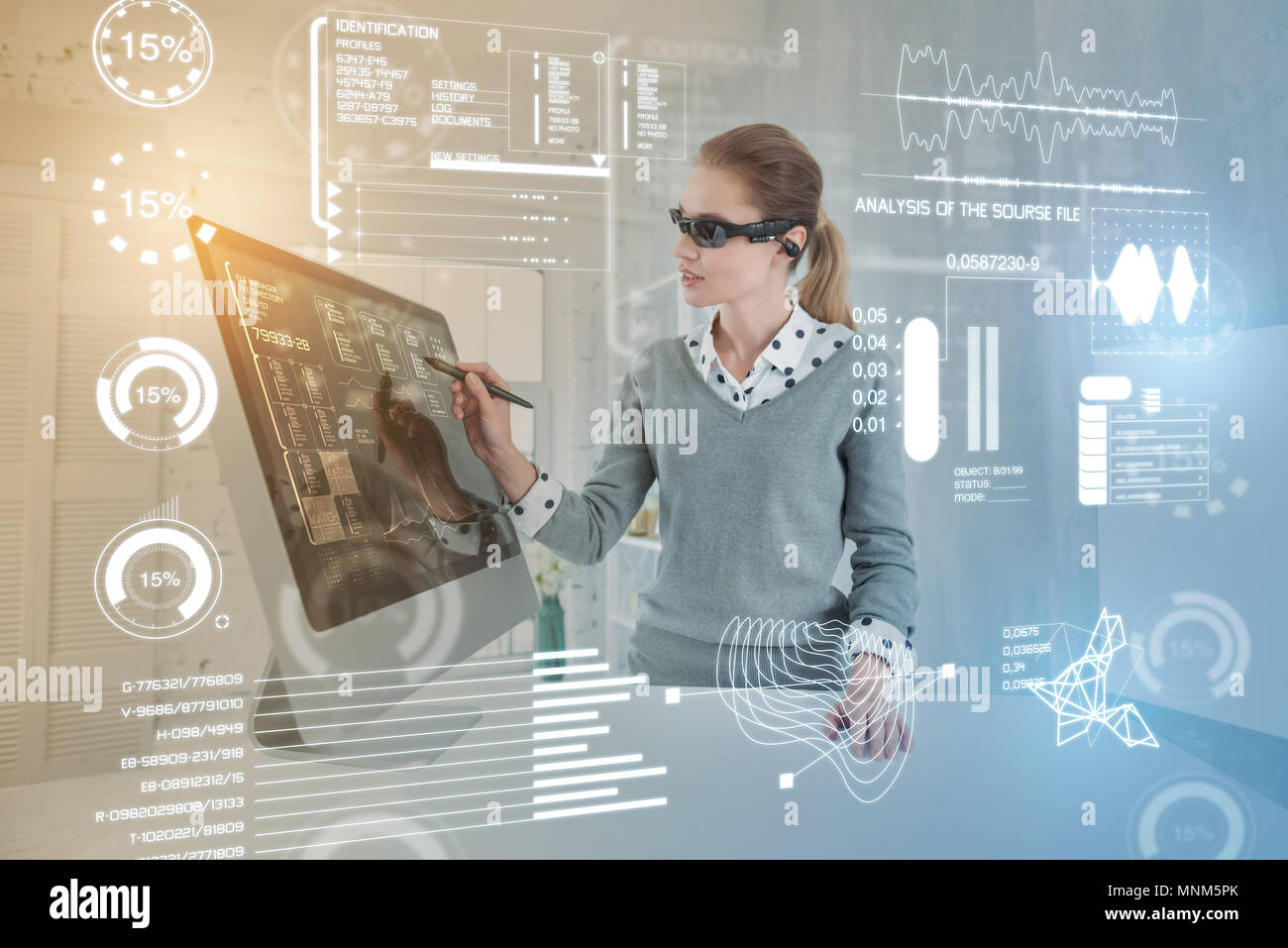 Smart database administrator wearing virtual reality glasses while working Stock Photo