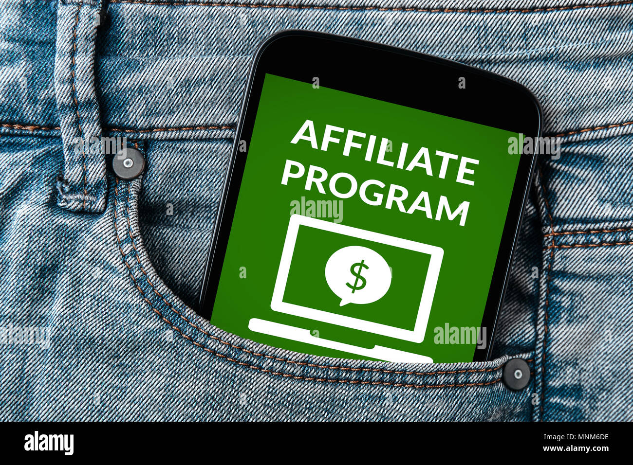 Affiliate program concept on smartphone screen in jeans pocket. All screen content is designed by me. Flat lay - Stock Image