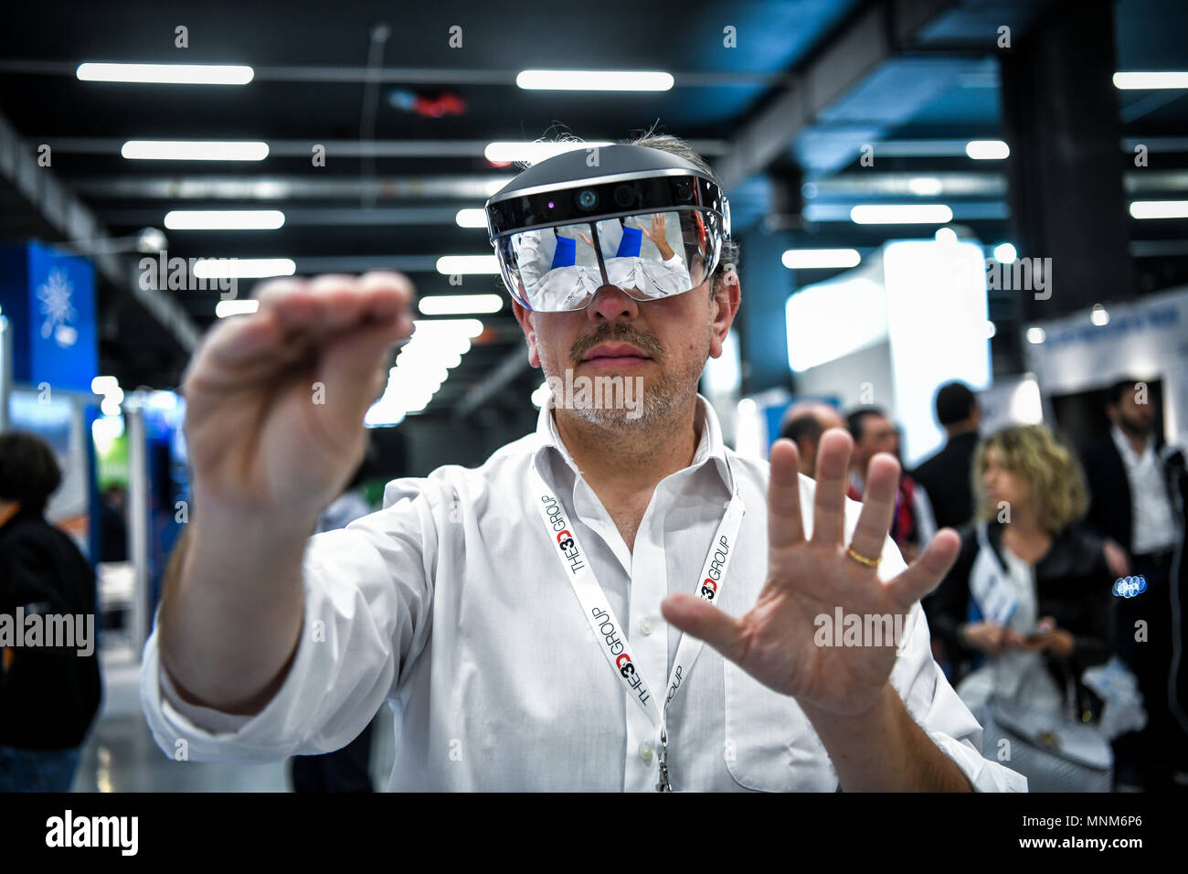 Milan, Italy - 17 May 2018: a man wearing a VR Virtual Reality headset gesticulates during the Technology Hub 2018. - Stock Image