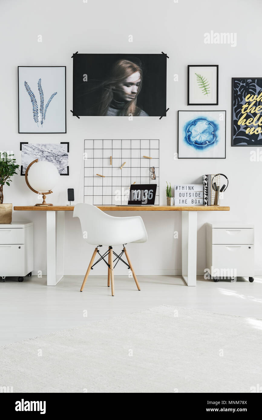 Desk And Posters In Trendy White Home Office Stock Photo ...