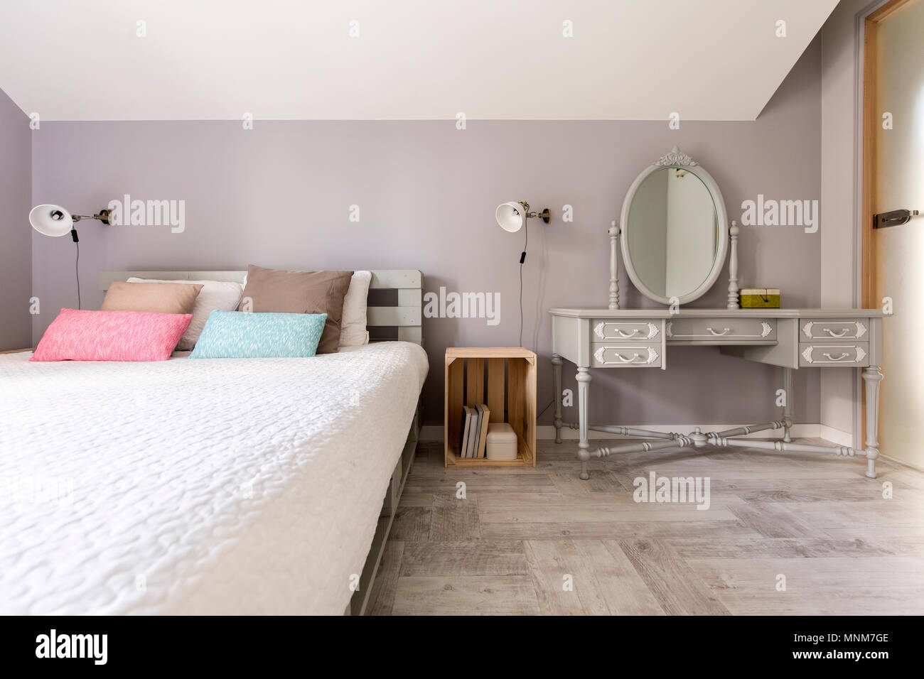 Shot of a modern bedroom with king-size bed - Stock Image