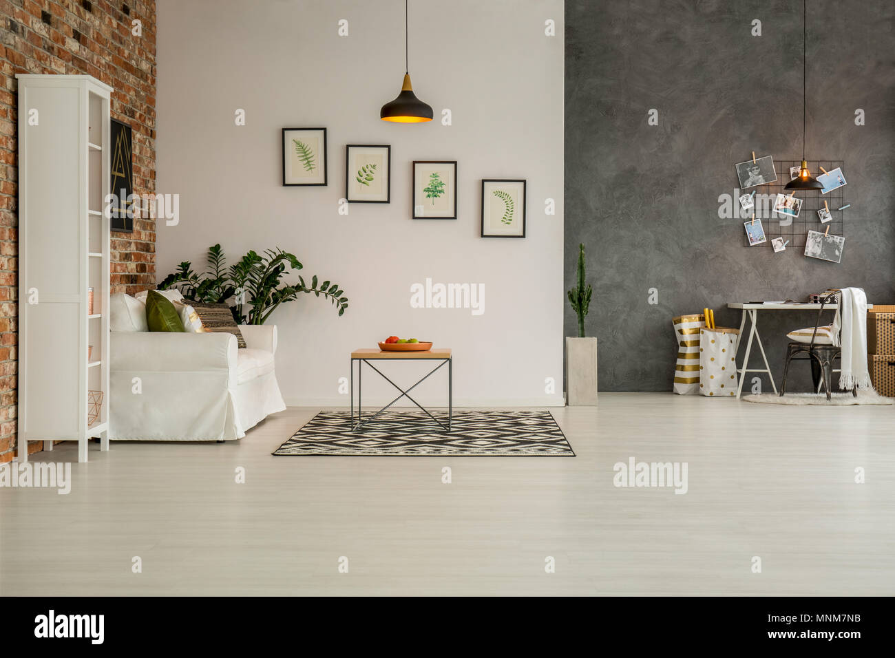 Modern apartment with living room open to home office - Stock Image