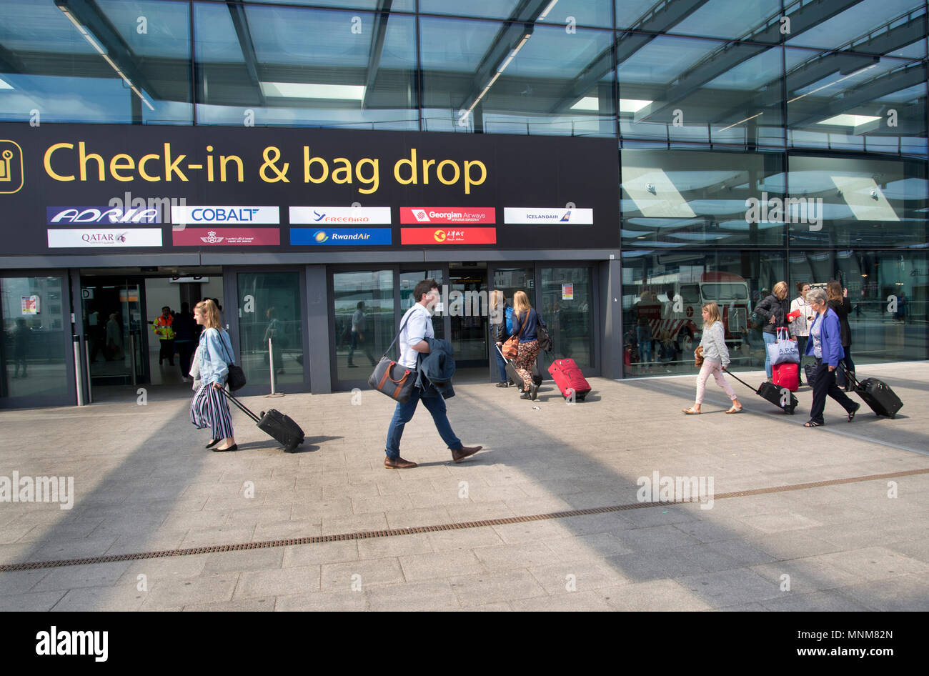 Gatwick airport , Sussex, England. North Terminal. Check-in and bag drop. - Stock Image