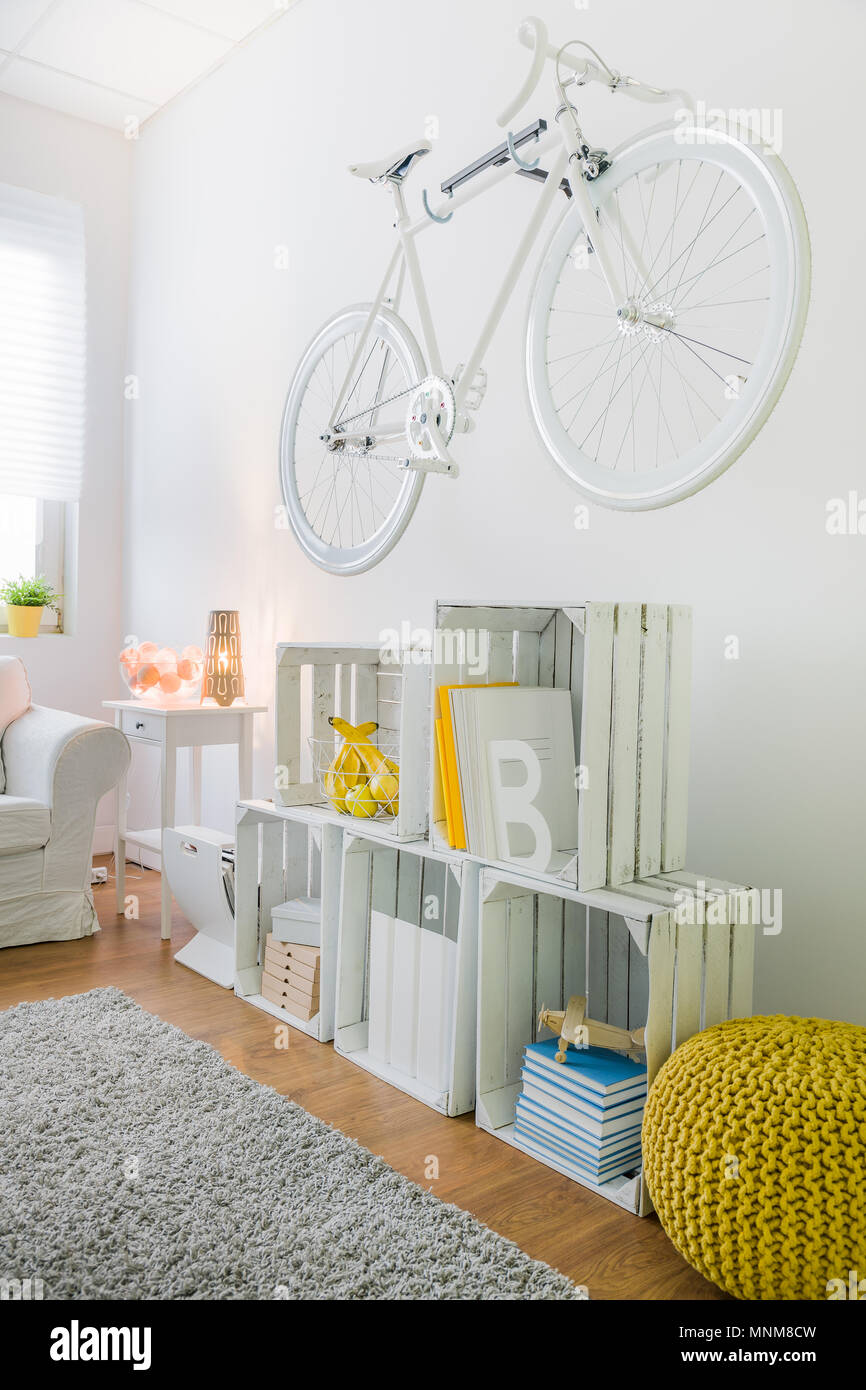 Vintage style bicycle as a decoration on wall in modern living room ...