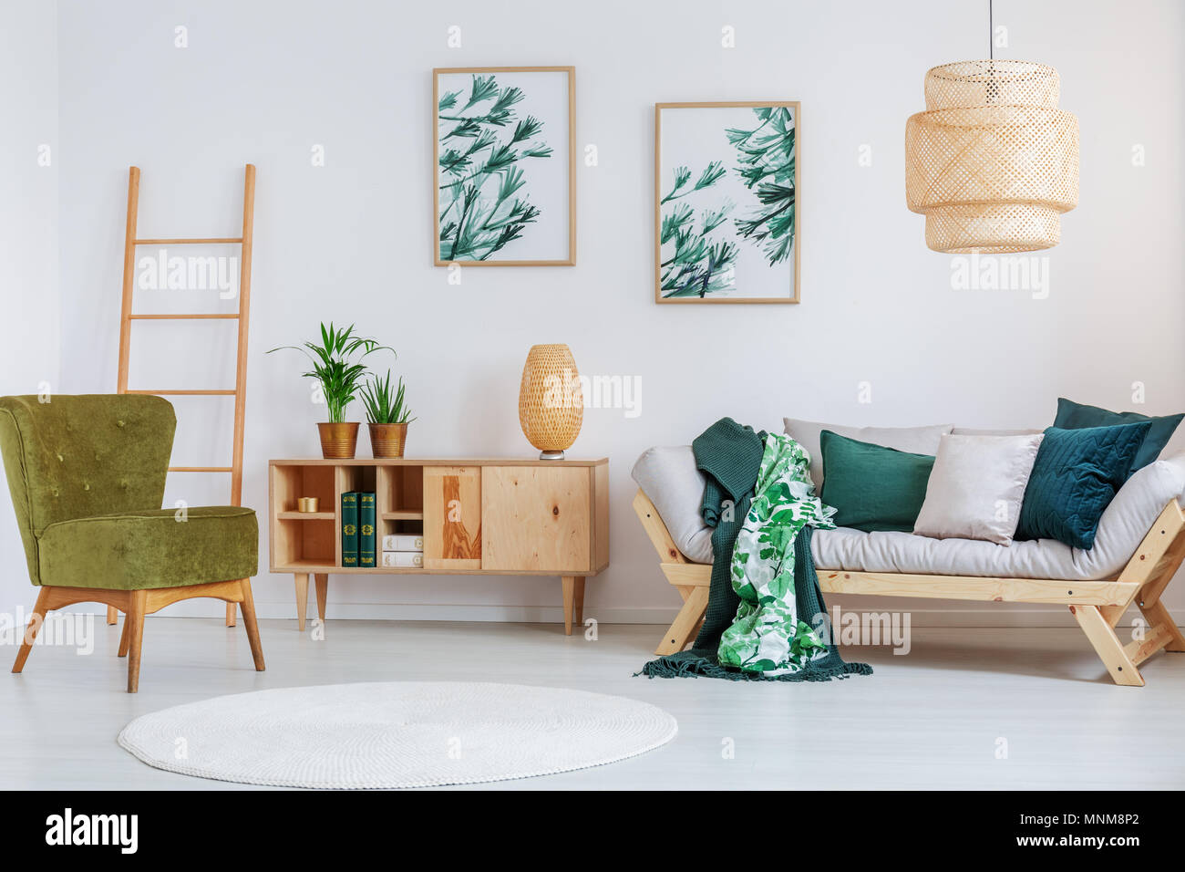 Pear green chair near cupboard with creative lamp in living room ...