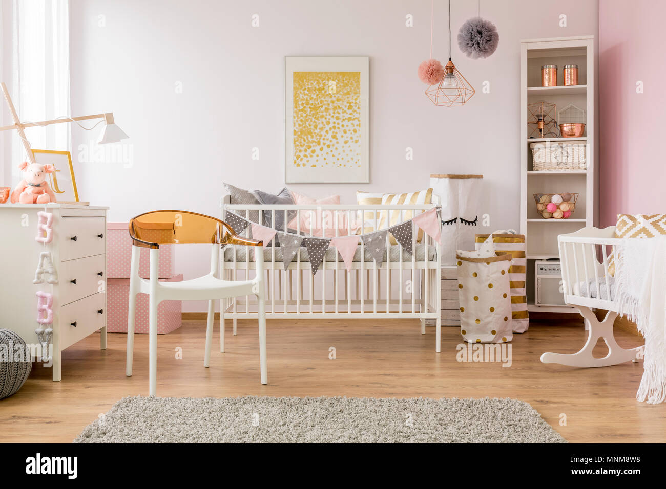 Baby bedroom with white chair, cot, dresser, cradle and bookcase ...