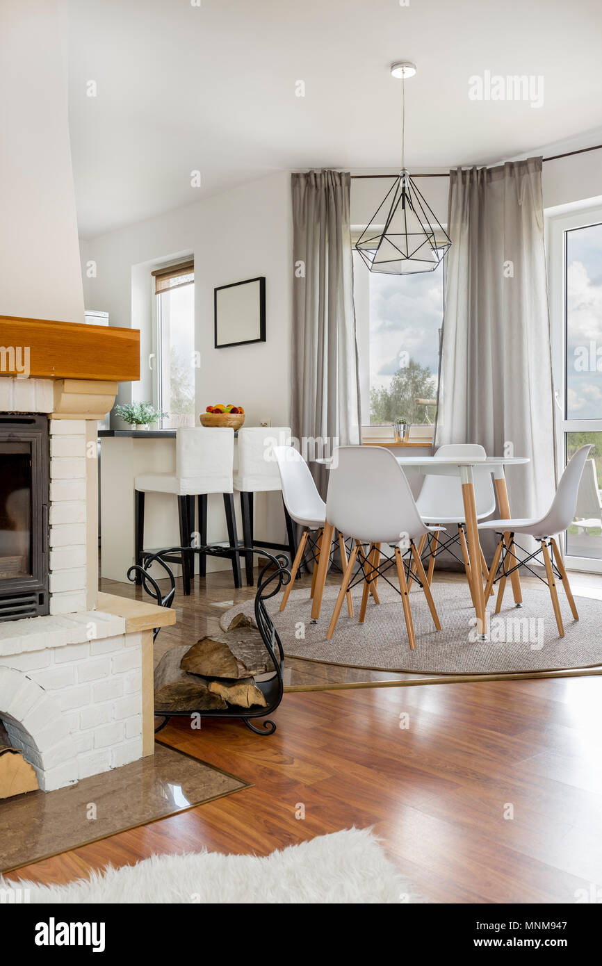 Open floor house with fireplace, dining area and kitchen Stock Photo
