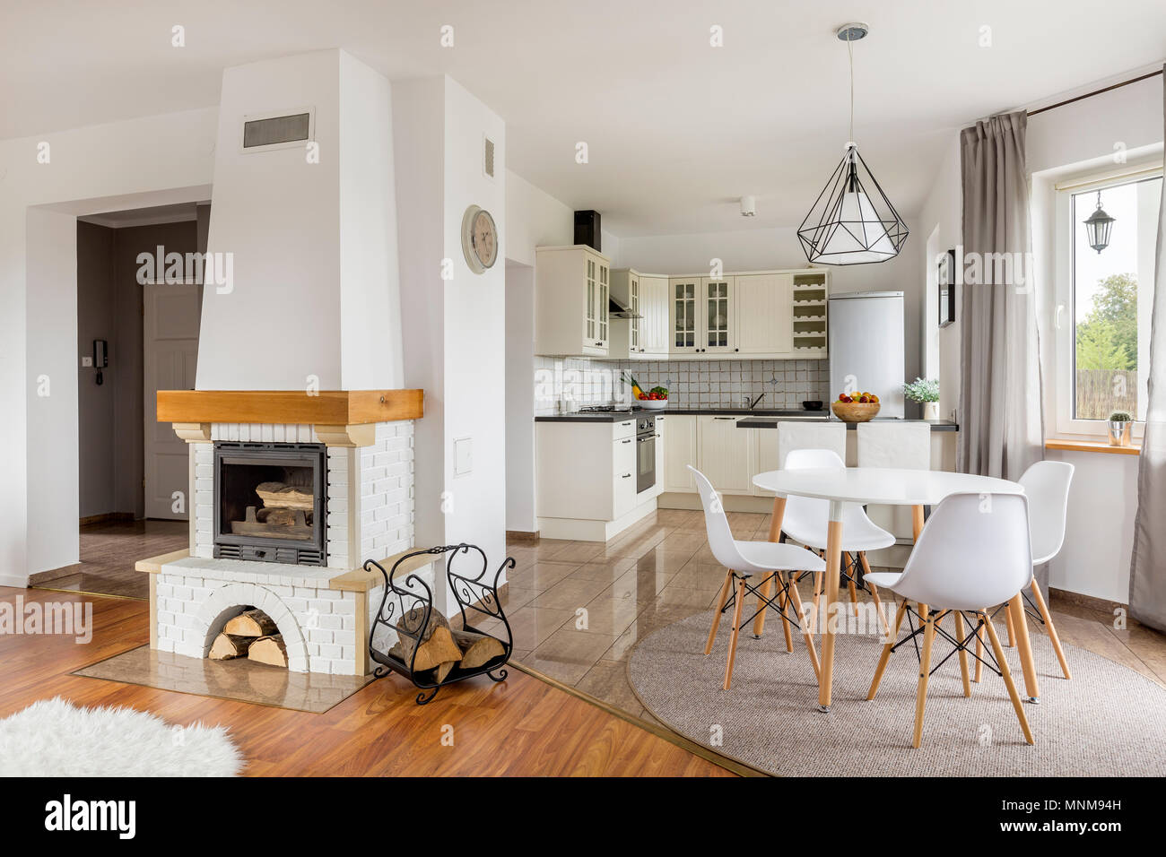 Open Floor Flat With Fireplace Dining Area And Light Kitchen