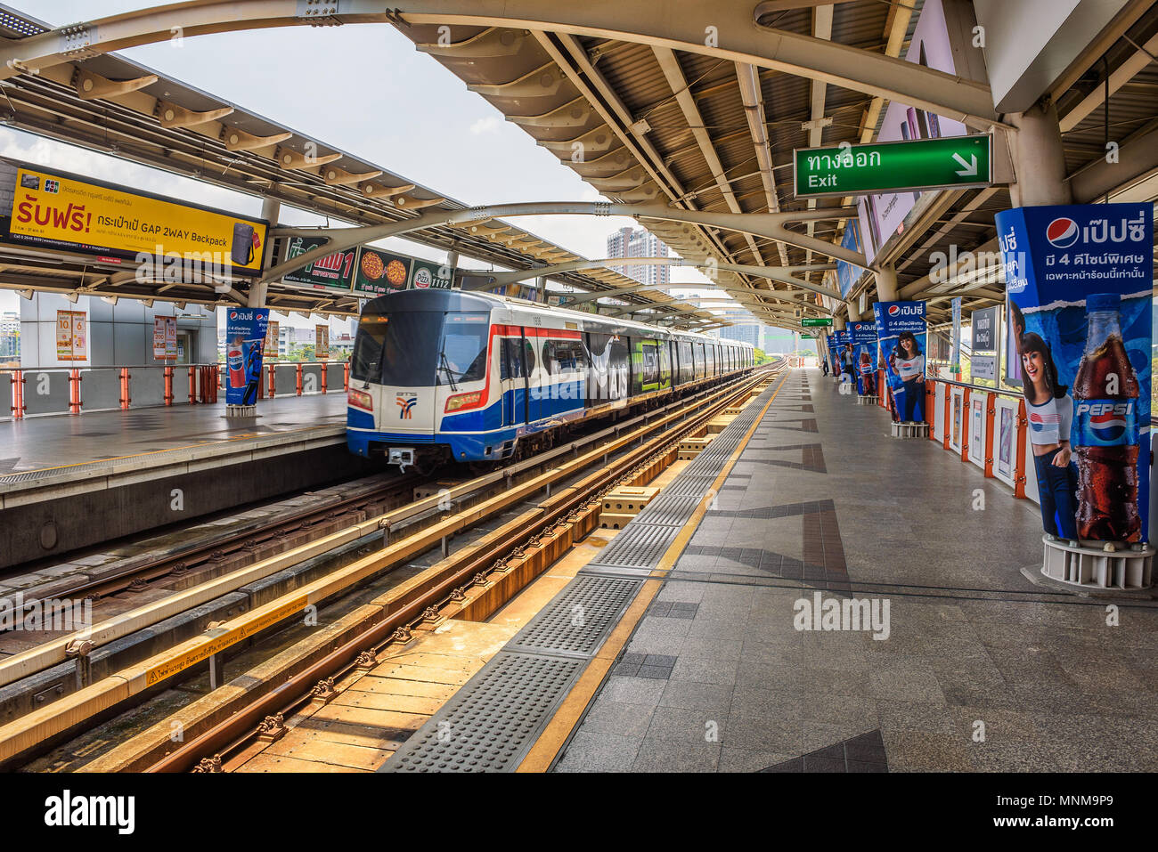 Train at Skytrain Station in Bangkok Stock Photo