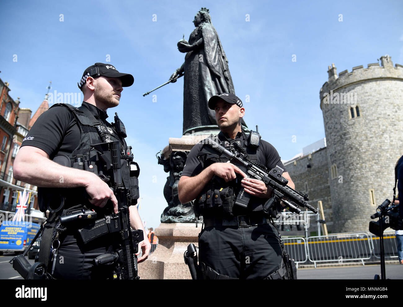Armed Police outside Windsor Castle Credit: Finnbarr Webster/Alamy Live News - Stock Image