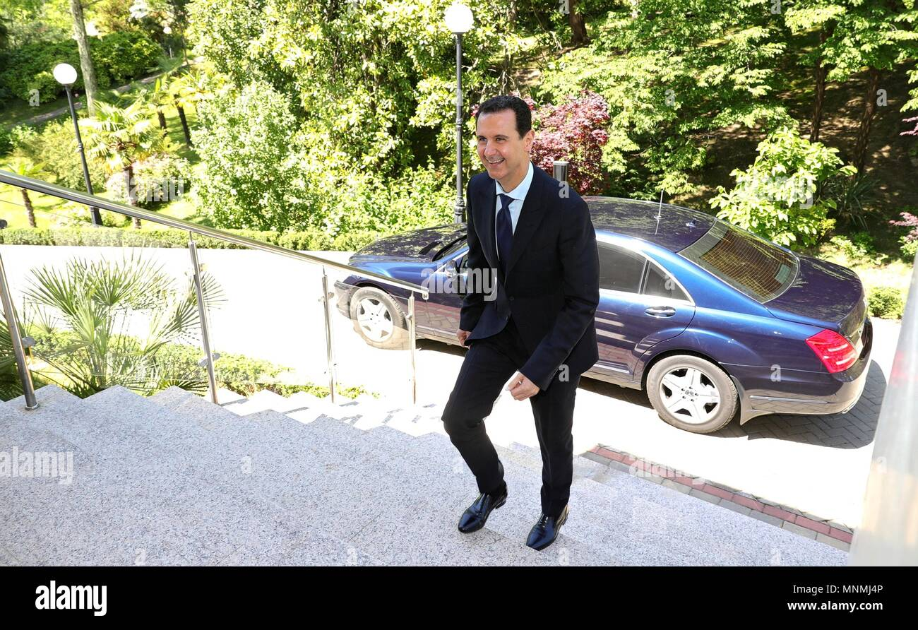Syrian President Bashar al-Assad smiles as he arrives to meet with Russian President Vladimir Putin at the Black Sea resort residence May 17, 2018 in Sochi, Russia.   (Russian Presidency via Planetpix) - Stock Image