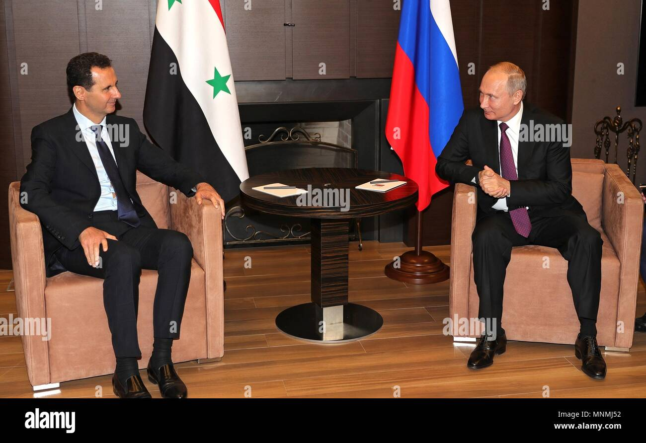 Russian President Vladimir Putin holds a bilateral meeting with Syrian President Bashar al-Assad at his Black Sea resort residence May 17, 2018 in Sochi, Russia.   (Russian Presidency via Planetpix) - Stock Image