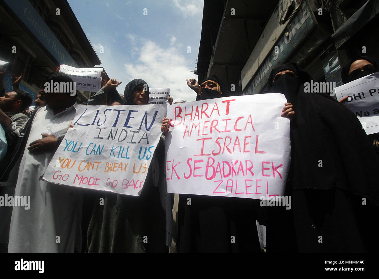 Srinagar, Jammu and Kashmir. 18th May, 2018. Activists and members of Joint Resistance Leadership (JRL) of Kashmir hold placards as they shout anti-Israel slogans during the protest in Srinagar the summer capital of Indian controlled Kashmir on May 18, 2018. More than 60 Palestinian protesters have been killed after Israeli forces opened fire on the Gaza border on May 14, who had assembled alongside the fence to protest against the moving of United State's embassy from Tel Aviv to Jerusalem. - Stock Image
