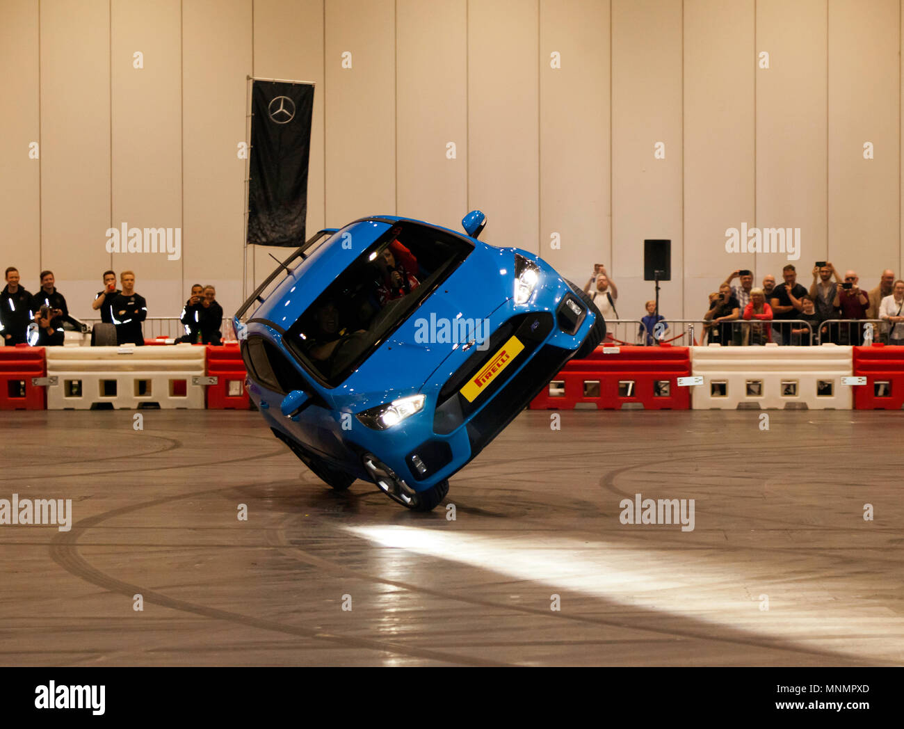Stunt driver, Paul Swift drives his Ford Focus RS on two wheels, during his live precision driving  show, at London Motor Show 2018. Stock Photo