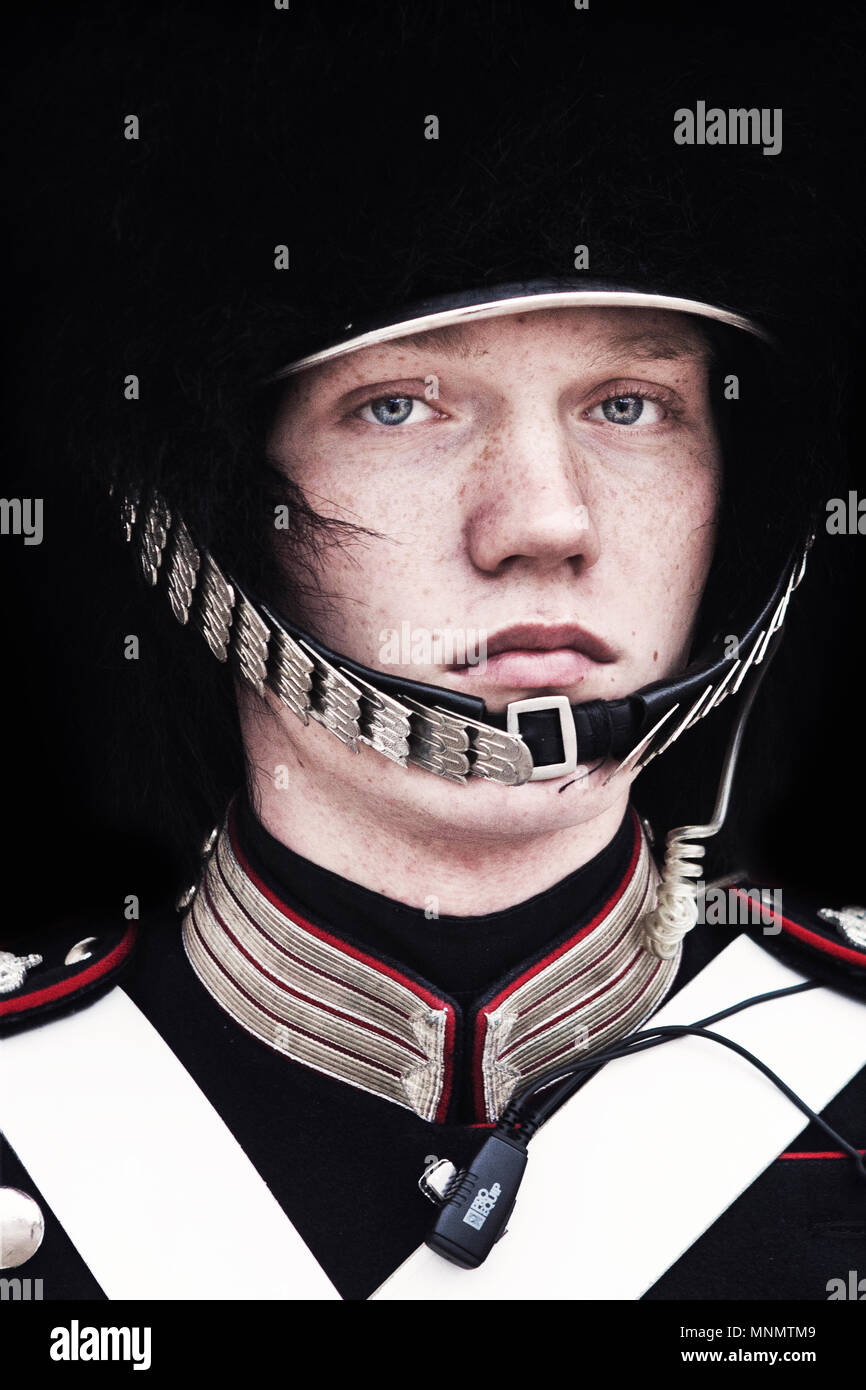 Portrait of a soldier from the Danish Royal Life Guard outside the royal family residence Amalienborg Palace in Copenhagen, Denmark. The Danish Royal Family usually spend their winter time at Amalienborg, which is a main tourist attraction in Copenhagen. - Stock Image
