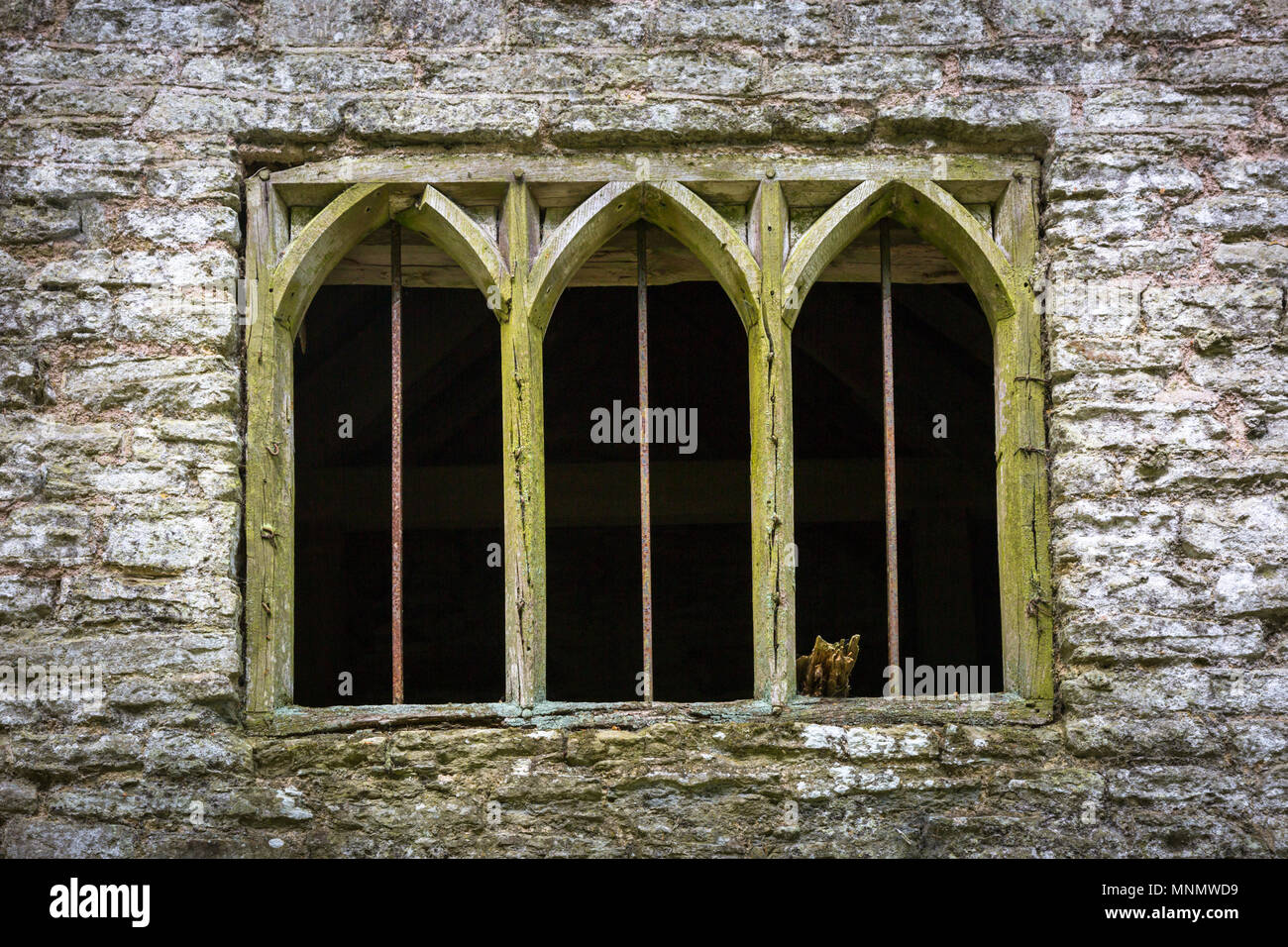 Old wooden or timber mullions window frames in a stone building Stock Photo