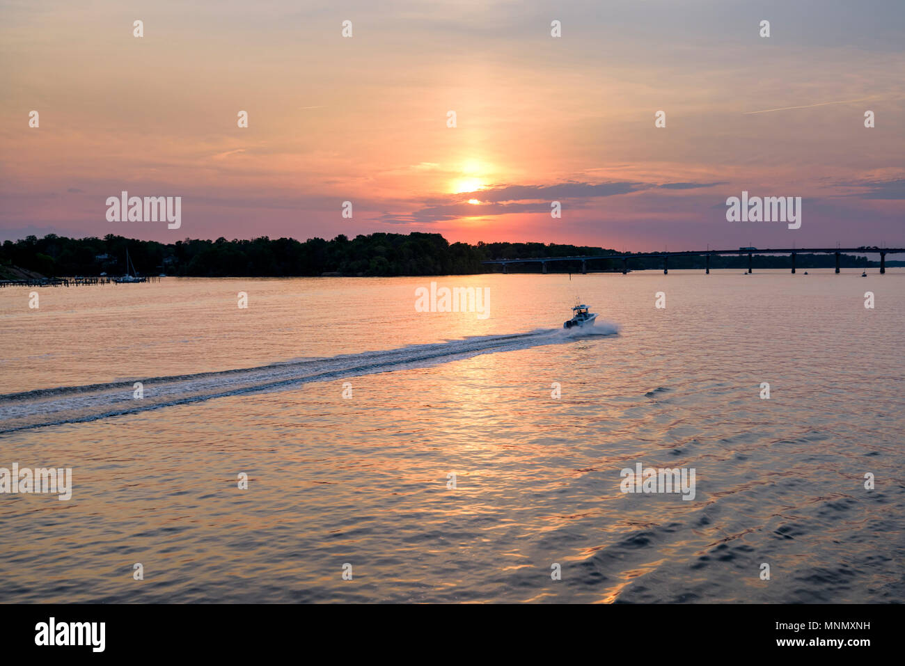 A speedboat travels on the Severn River near Annapolis, Maryland. - Stock Image