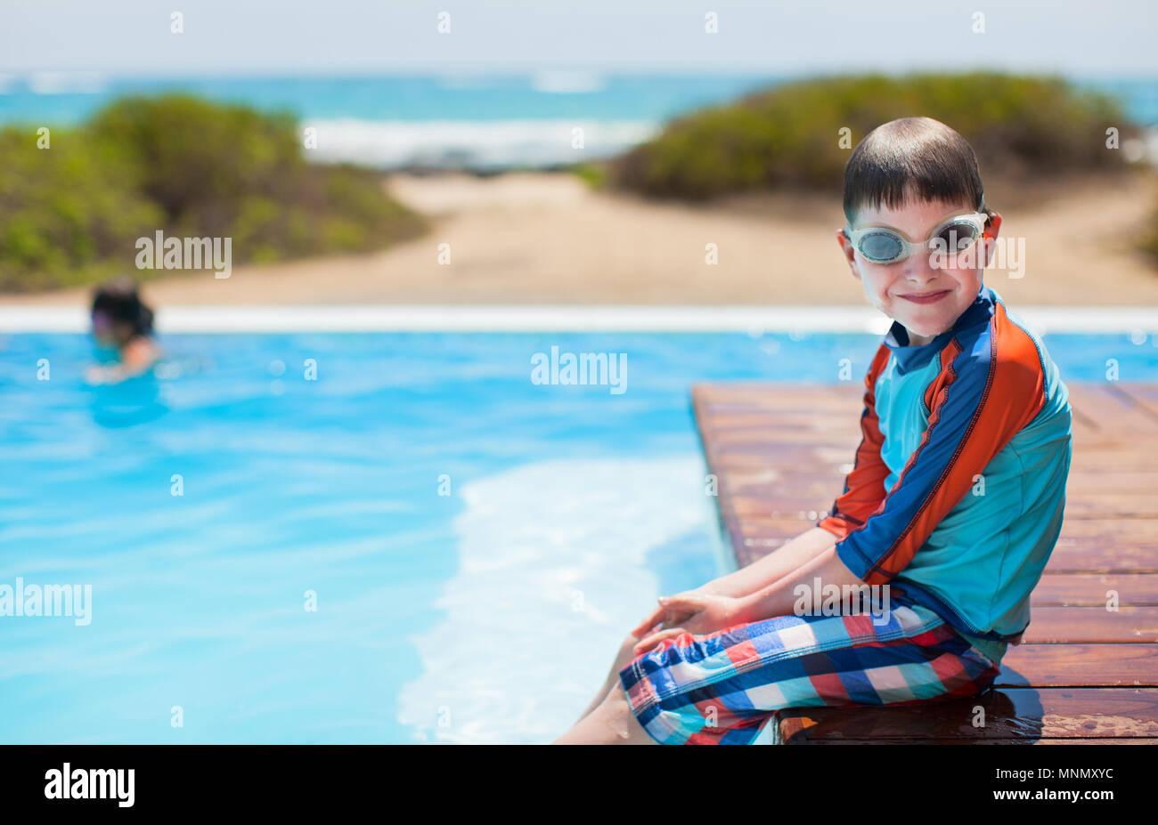 Real cute boy in pool