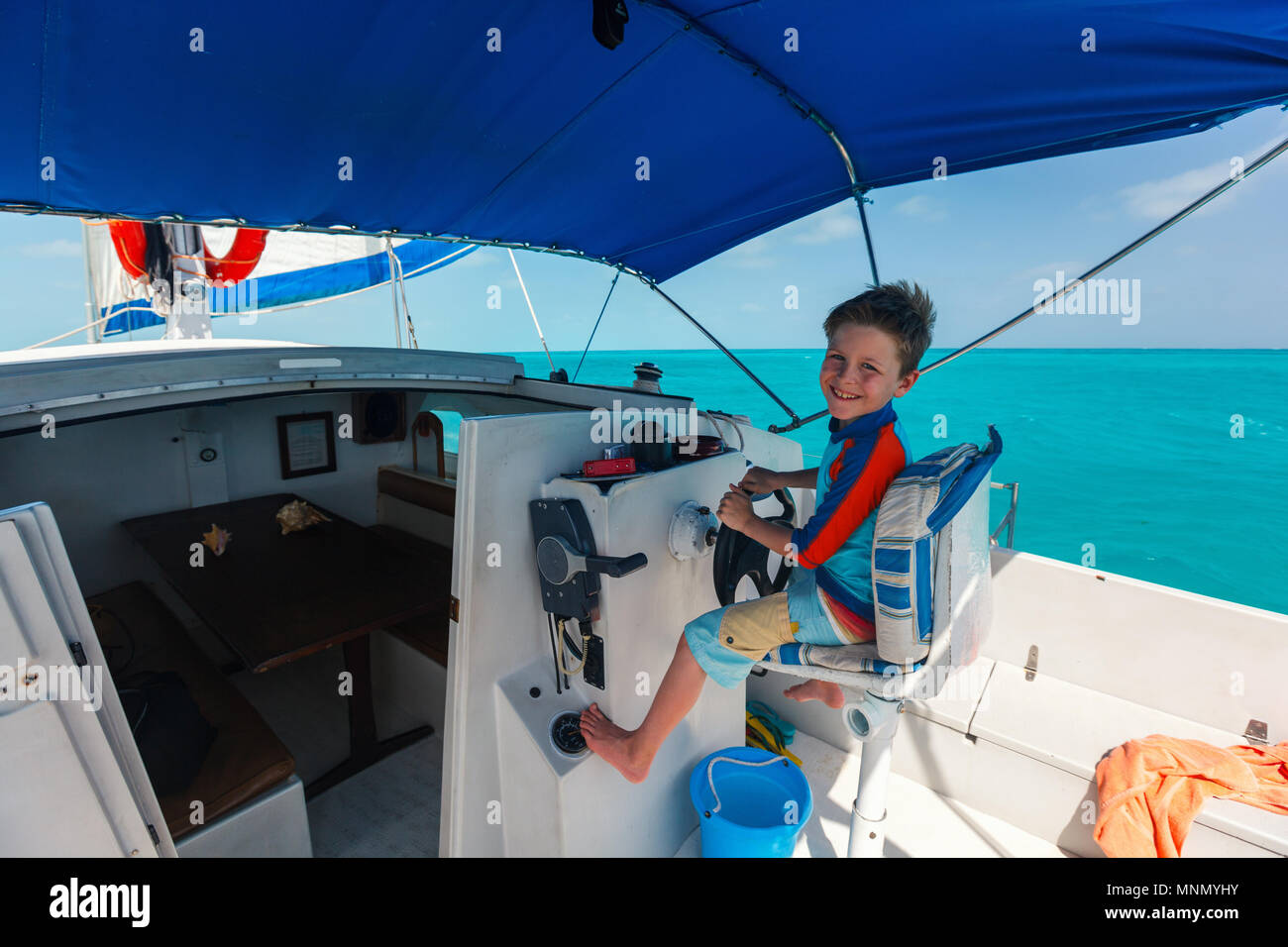 Cute little boy at sail boat wheel Stock Photo