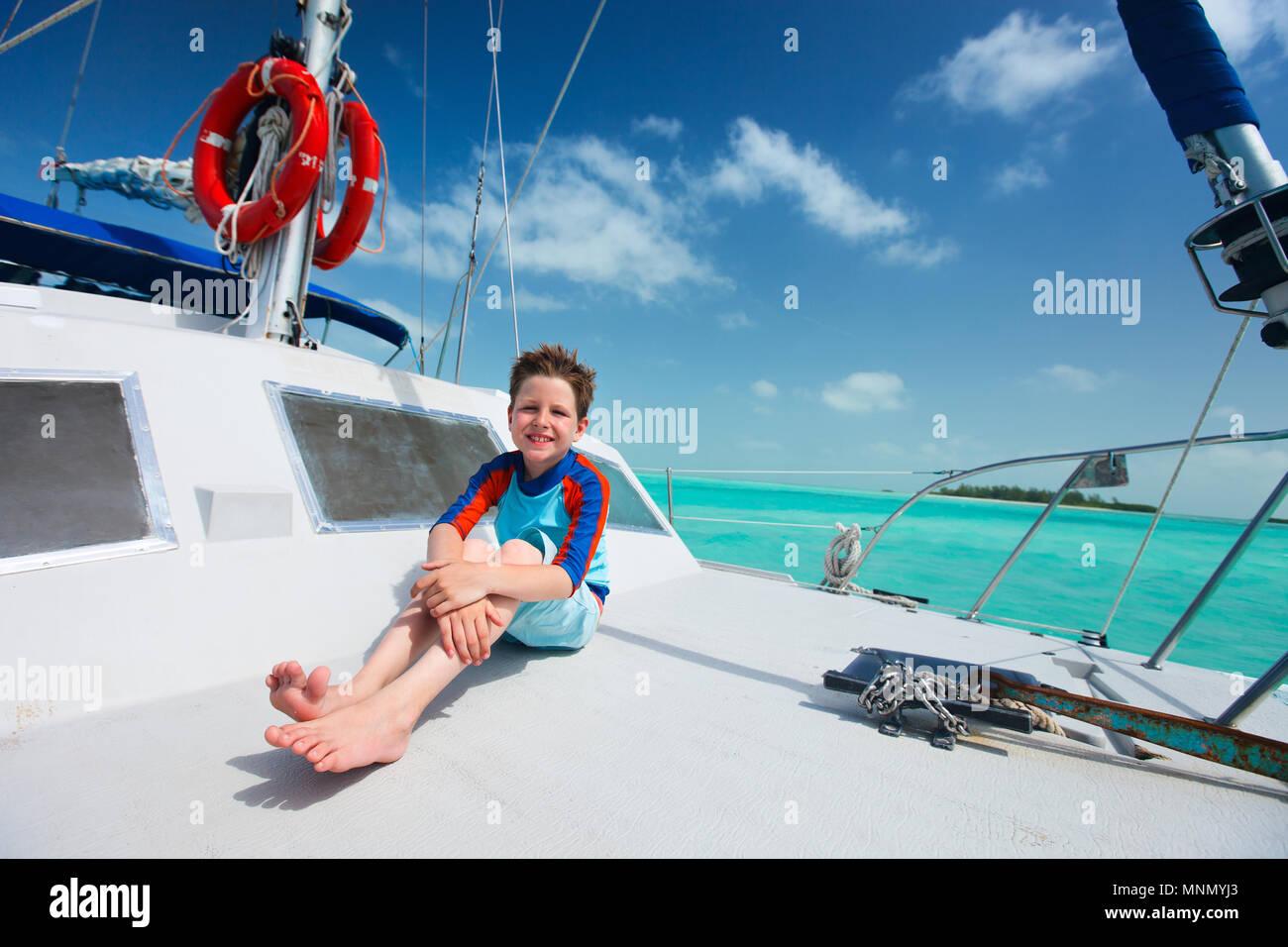 Little boy enjoying ride on a luxury yacht - Stock Image