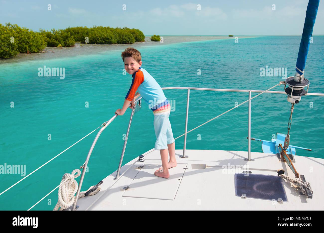 Little boy enjoying ride on a luxury yacht Stock Photo