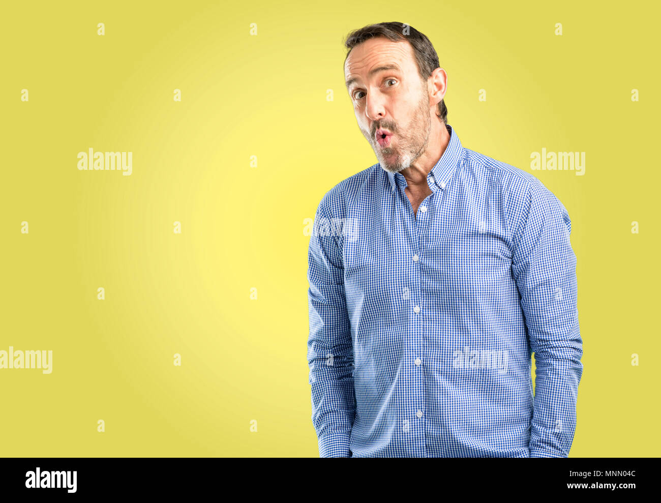 Handsome middle age man happy and surprised cheering expressing wow gesture - Stock Image