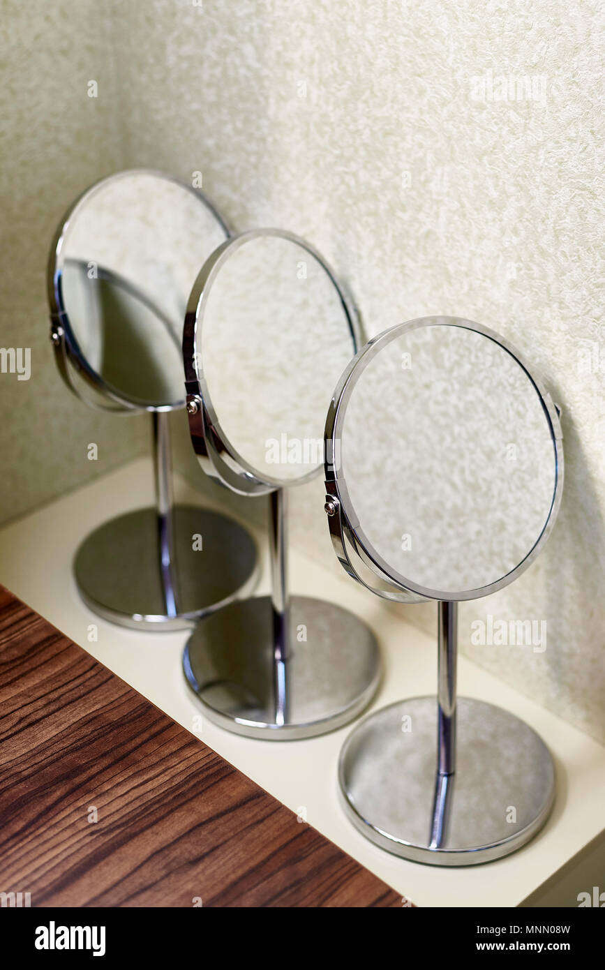 Charmant Mirrors For Make Up Stand On The Table Near The Wall.