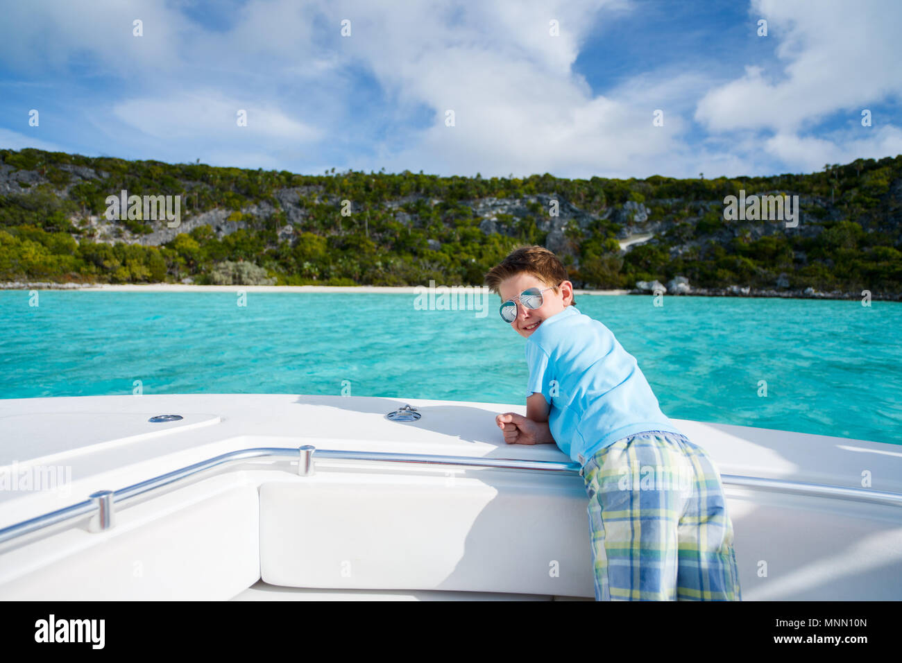 Little boy enjoying vacation on a luxury yacht or private tour boat Stock Photo