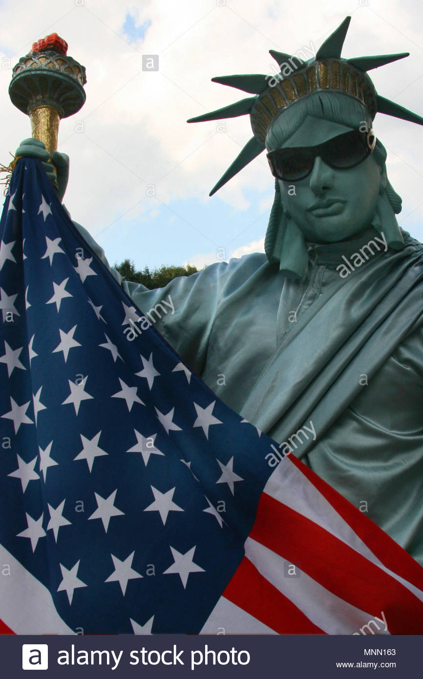 New York, United States of America - A street performer dressed as the Statue of Liberty in Central Park. Stock Photo